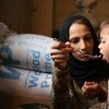 A mother, displaced with her family, feeds her 18-month-old daughter at a shelter in a village rural Damascus. (file)
