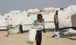 A five year-old boy carries an empty water jerry in Al-hol camp in north-eastern Syria, hosting over 4,600 Iraqi refugees. Like most children there, he bears the brunt of carrying water for his family.