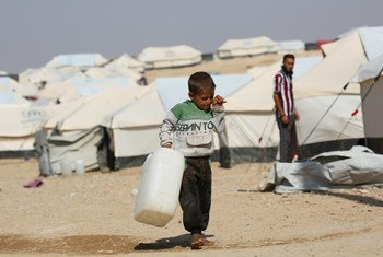 A five-year-old child carries an empty jerrycan in the Al Hol camp in northeastern Syria. The camp houses nearly 40,000 children from more than 60 countries.