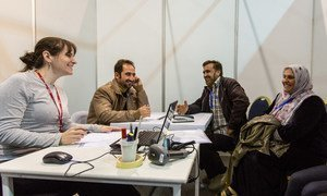 A Syrian family is successfully interviewed by Canadian officials through the help of an International Organization for Migration (IOM) interpreter at a resettlement programme carried out in Jordan.