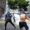 Manifestantes em Caracas, na Venezuela.