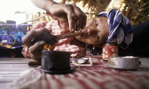 According to the INCB, only one in five women addicted to drugs are able to access treatment facilities. Seen here is a woman from a hill tribe in Thailand smoking opium (file).