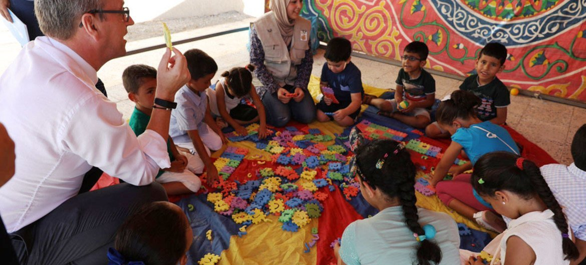 UN Children's Fund (UNICEF) Regional Director for the Middle East and North Africa, Geert Cappelaere, interacts with children at a UNICEF-supported Child Friendly Space in Tripoli, Libya.