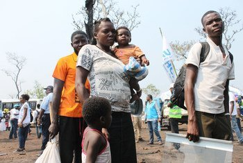 Families who fled militia attacks in Kasai Province in the Democratic Republic of the Congo arrive at the newly established Lóvua settlement in northern Angola.