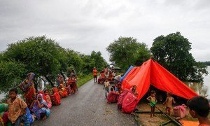 People displaced by the floods take temporary refuge along a road in southern Nepal.