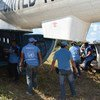 UN observers removing  the last of more than 8,112 guns carried by the FARC-EP.