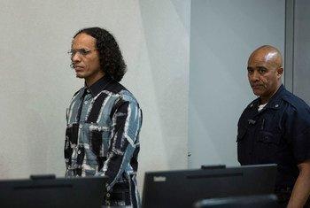 Ahmad Al Faqi Al Mahdi (left) is escorted to Trial Chamber VIII of the International Criminal Court (ICC) in The Hague.