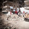 Trabajadores humanitarios entregan ayuda en Siria.