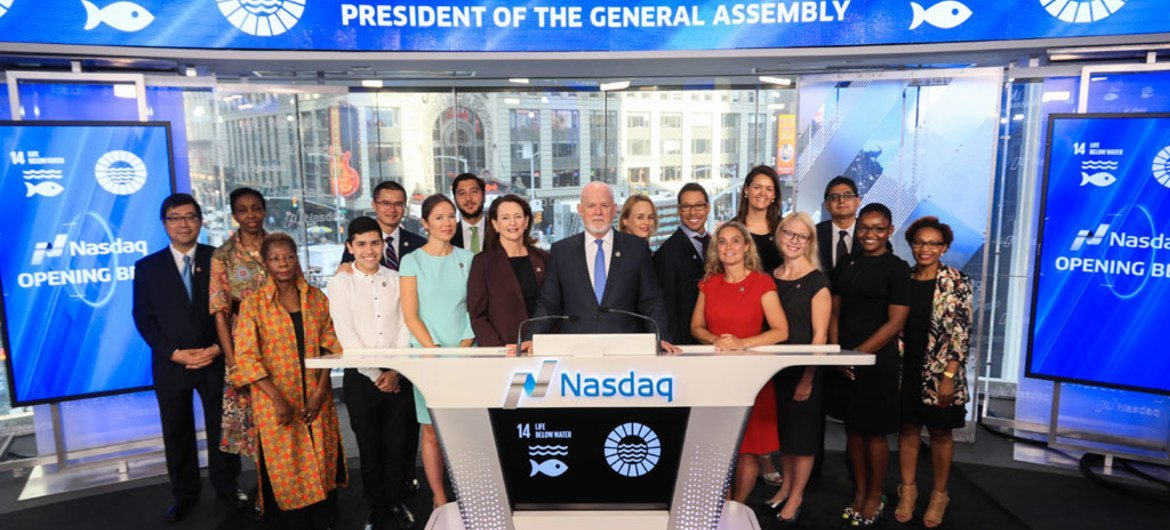 Peter Thomson, President of the 71st Session of the United Nations General Assembly (at podium), rings the Nasdaq Opening Bell.