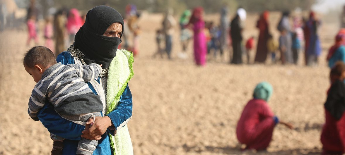 Displaced children and adults shown here fled ISIL-controlled areas in rural Raqqa to Ain Issa, the main staging point for displaced families, some 50 Km north of Raqqa City.