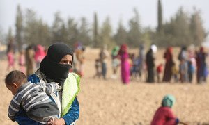 Displaced children and adults shown here fleeing ISIL-controlled areas in Syria. (file)