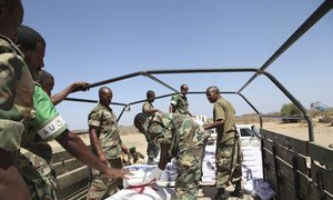 Foodstuff being loaded onto a truck at Baidoa Airport. It is part of the support that UNSOM will be giving to SNA soldiers as they fight alongside AMISOM troops. AU/UNISTPHOTO /Mohamed Guled