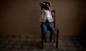 An eight-year-old girl hides her face at a UNICEF-supported centre in Haiti that provides temporary care and support for trafficked children while authorities search for their parents. (file)