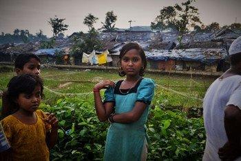 Rohingya refugee children from Myanmar stand outside Kutupalong camp in Bangladesh (July 2017).