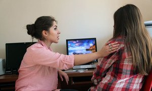 A psychologist talks to a young woman victim of rape at the UNICEF supported 'Rodnik' shelter for child trafficking victims in the city of Almaty, Kazakhstan.