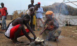 Burundian refugees prepare food over an open flame at a settlement in the Democratic Republic of the Congo (File)