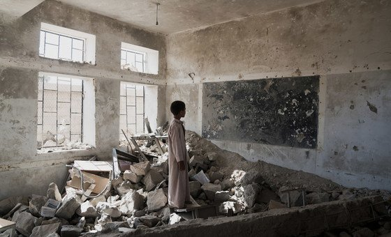 A student stands in the ruins of one of his former classrooms, which was destroyed in June 2015, at the Aal Okab school in Saada, Yemen. Students now attend lessons in UNICEF tents nearby.