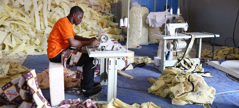 An employee of Vita Foam hard at work in Freetown, Sierra Leone (June 2015).