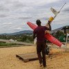 A man in Rwanda using a drone to deliver blood to a remote clinic.