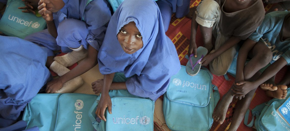 Children attend lessons at a UNICEF-supported school in Dikwa, Borno state, north-east Nigeria. The region was under the control of Boko Haram insurgents until the Nigerian army liberated it in February 2016.
