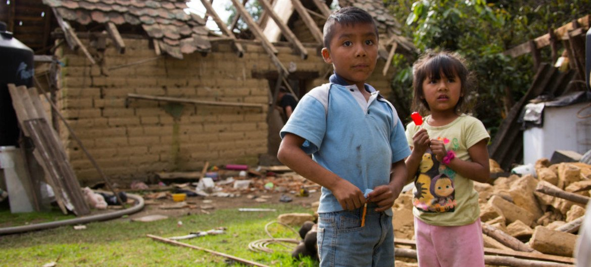 Iker, 9, and his sister Yeimire, 6, stand outside their home which was destroyed in an earthquake in San Andrés Hueyapan, Tetela del Volcán municipality, Morelos, Mexico, Thursday 21 September 2017.