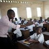 Children in their classroom as the teacher conducts the lesson at the St. Louis Primary School in Kinshasa, Democratic Republic of the Congo.
