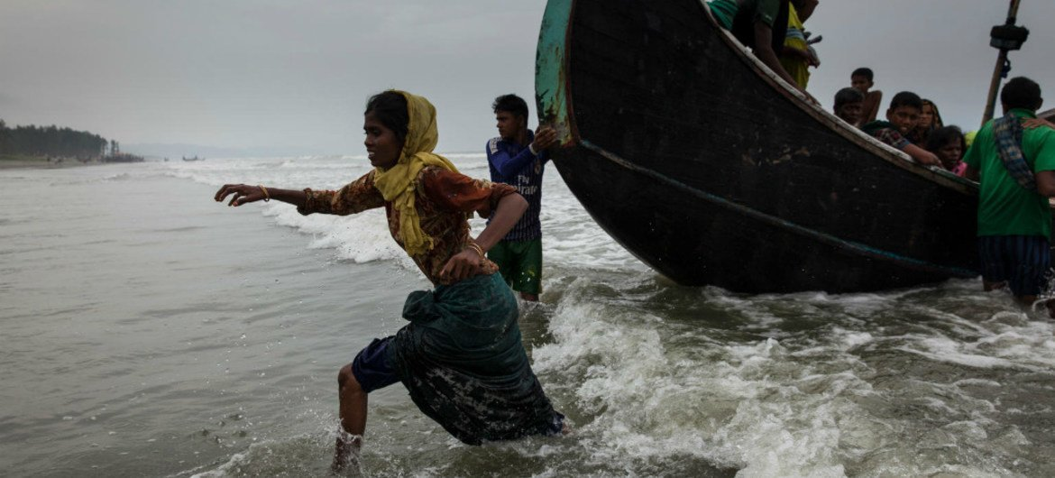 Rohingya refugees walk ashore at Shamlapur beach in Cox's Bazar district in Bangladesh, after crossing the Bay of Bengal. (File)