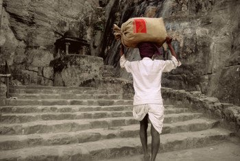 A rural postman of India delivers letters in Rajhastan, India.