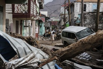 A woman walks in the street of Roseau, capital of Dominica, which has struggled to overcome the severe impact of two category 5 hurricanes which tore through the region in September 2017.