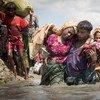 Thousands of new Rohingya refugee arrivals cross the border near Anzuman Para village, Palong Khali, Bangladesh.