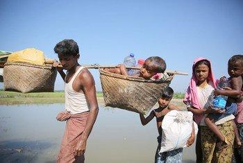 Rohingya refugees cross into Bangladesh from Myanmar at the Anjumanpara border crossing point.