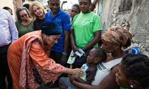 Deputy Secretary-General Amina Mohammed (foreground left) and UN Special Envoy for Haiti Josette Sheeran (rear left) with Haitian families affected by cholera.