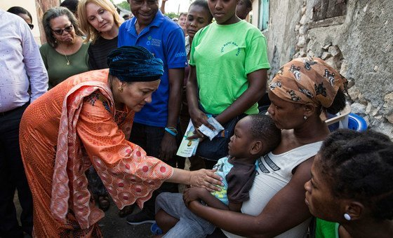 Deputy Secretary-General Amina Mohammed (left) and UN Special Envoy for Haiti Josette Sheeran (rear left) with Haitian families affected by cholera.