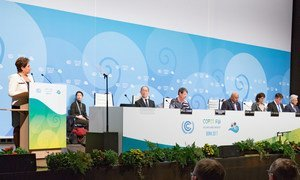Patricia Espinosa, Executive Secretary of the UN Framework Convention on Climate Change (UNFCCC), at podium, addressing the opening ceremony of the Bonn Climate Conference.