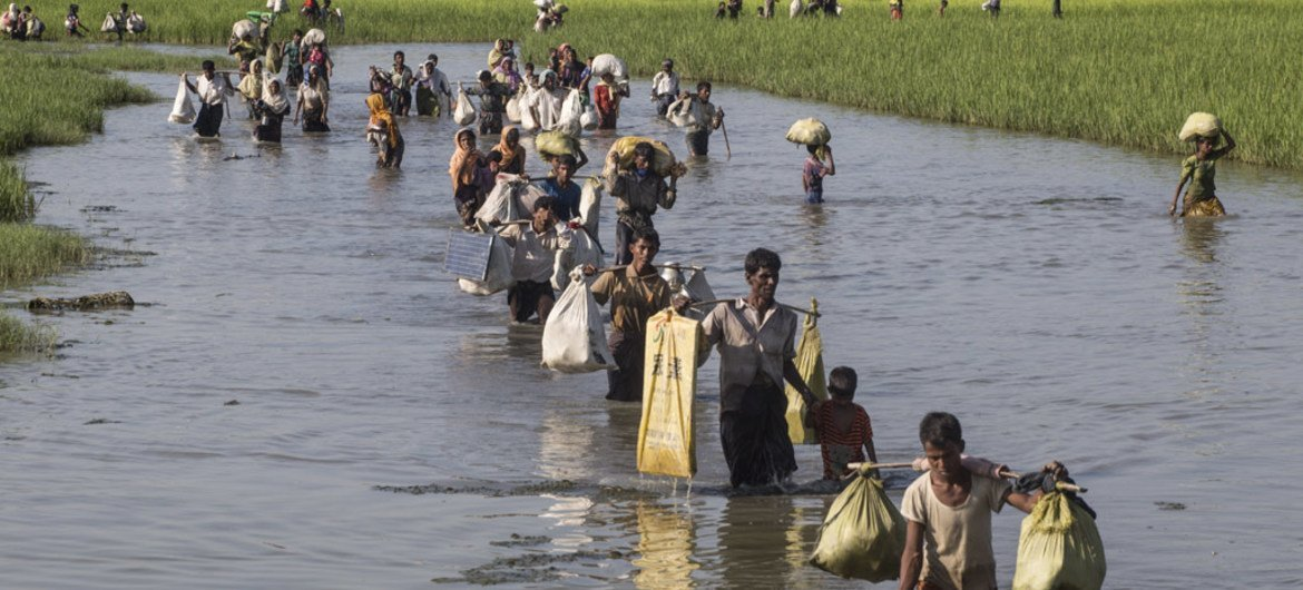 In this photo taken in mid-October 2017, Rohingya refugees that have fled Myanmar's Rakhine state, cross into Bangladesh at Palong Khali in the Cox's Bazar district. UNICEF/LeMoyne