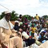 Civilians on board trucks during a previous IOM relocation of internally displaced persons in the Central African Republic.