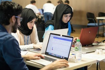 """Young people participating in a """"Hack for Health"""" event at the 2017 World Summit on the Information Society."""