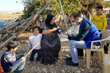 Families in Kani Bardina village, Sulaymaniyah governorate, receive health check-ups and assistance from IOM Iraq Mobile Medical team, following an earthquake on the evening 12 November.