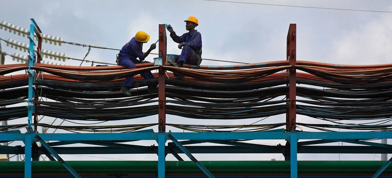 Workers maintain the thermal power station at Takoradi, Ghana (file).