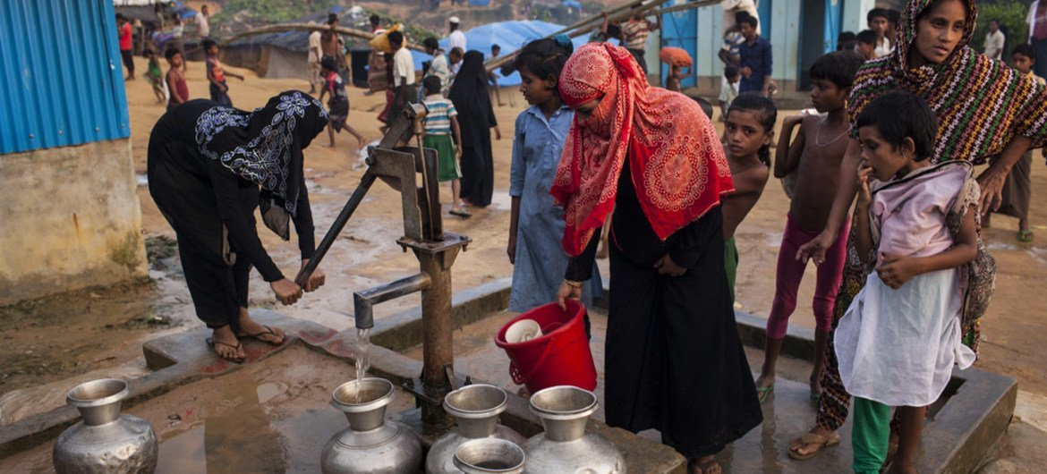 Women draw water from a pump installed by a non-governmental organization in the Kutupalong makeshift settlement for Rohingya refugees in Ukhiya, a sub-district of Cox's Bazar in Bangladesh.