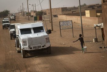 A convoy of MINUSMA vehicles drives through the streets of Menaka in northern Mali.