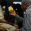 A man sells drugs for treating intestinal worm infection to passengers at a car park in Ikot Ekpene, Akwa Ibom State, Southern Nigeria.