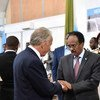 UN Special Representative of the UN Secretary-General for Somalia, Michael Keating (left), greets Somalia's Federal President Mohamed Abdullahi Mohamed 'Farmaajo,' during the Somalia Security Conference being held in Mogadishu.