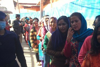Voters wait to cast their ballots for federal and provincial elections at a polling location in Bhaktapur district, Nepal.