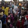 Families displaced by ongoing fighting in South Sudan arrive with their few possessions to register for a ration card that will allow them to get food aid at an emergency distribution site set up as part of an initiative run by UNICEF and the World Food Programme (WFP) in Thanyang, Unity state.