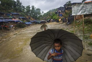 A young child walking through the Chonkhola camp for Rohingya refugees in Chakdhala, Bangladesh. Refugees are unable to leave the camp; due to a diphtheria outbreak, everyone must be vaccinated before they can be moved to the main camps around Kutupalong.