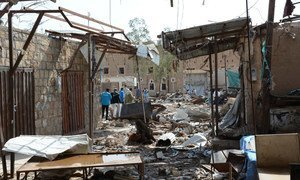 The Yemeni city of Sa'ada has been heavily hit by airstrikes since conflict in the country. Here, aid officials stand amid the rubble of a market in the old city of Sa'ada.