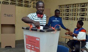 A voter in Liberia casting his ballot for a president in the second round of vote on 26 December 2017.