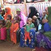 Mothers and their children in a queue waiting to receive measles vaccinations as part of a UNICEF-supported immunization campaign at the Beerta Muuri camp for internally displaced persons in Baidoa, Somalia (file).