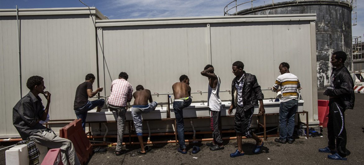 Somali and Eritrean refugees wash at a reception centre at the port of Augusta, Sicily. They had been rescued at sea by the Spanish Coast Guard after setting out from Libya. (file)